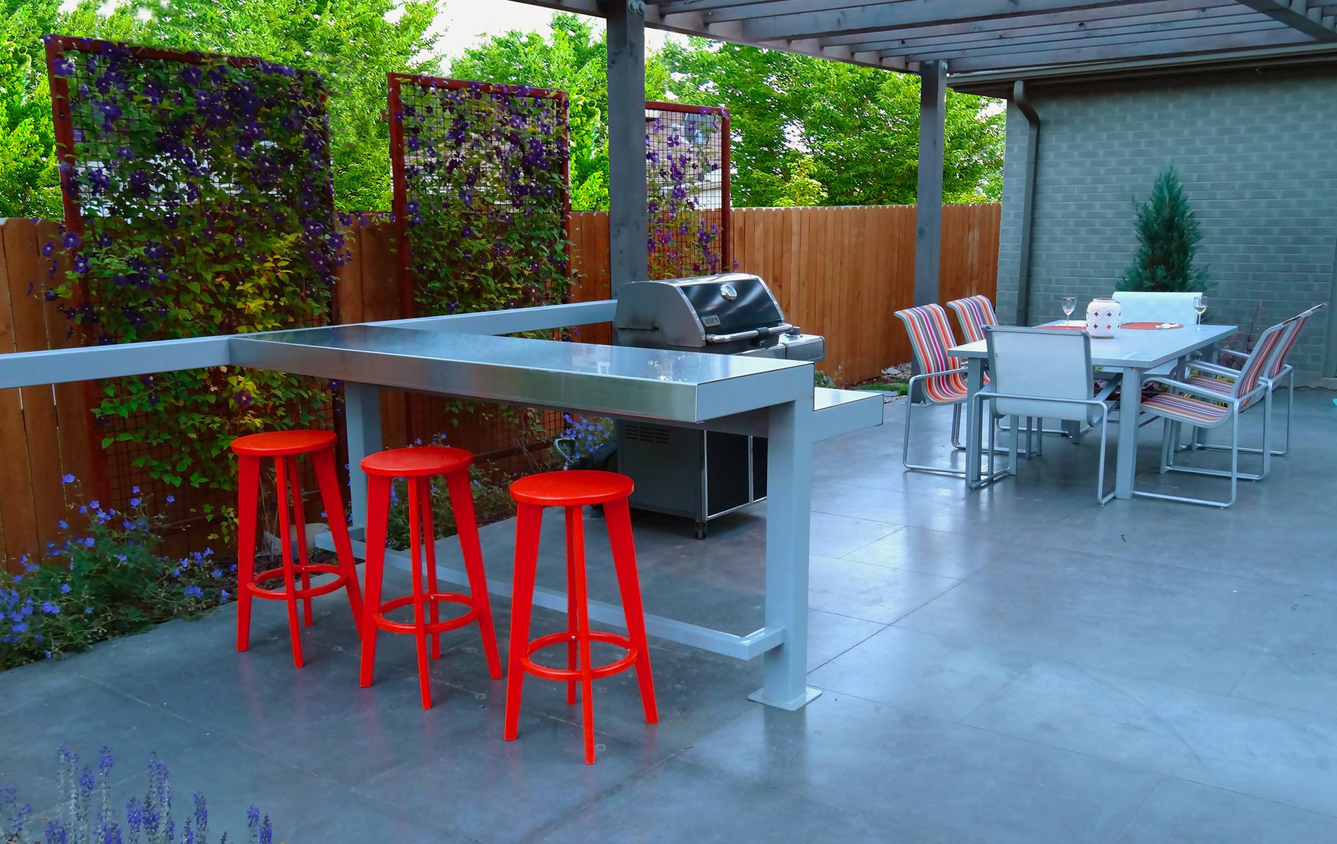 large outdoor living space with oversized pergola bar and rusted